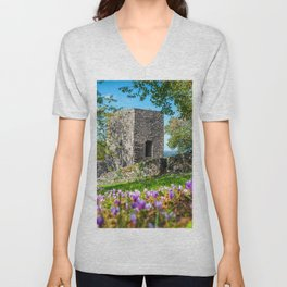 Square stone tower along medieval rampart in flowered meadow Unisex V-Neck