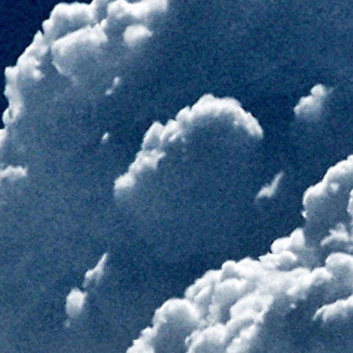 Puffy Cumulus clouds on Deep Blue Sky Leggings