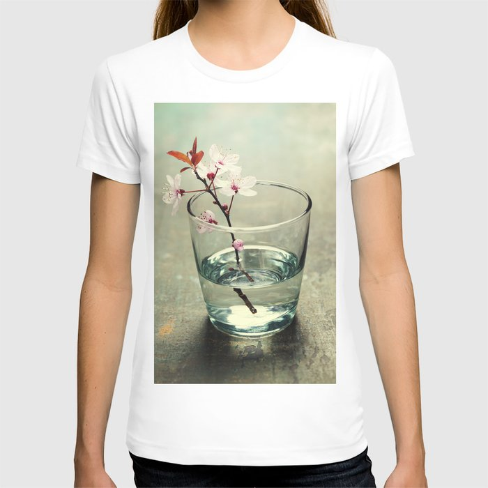 spring blossoms in glass vase on wooden surface T-shirt