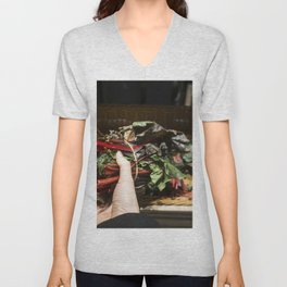 Choosing rhubarb in a grocery store Unisex V-Neck