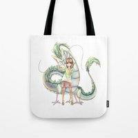 calcifer Tote Bags featuring Chihiro and Haku by CromMorc