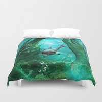 swimming Duvet Covers featuring Swimming dolphin by nicky2342
