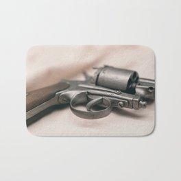 Ancient revolver. Old gun. Bath Mat