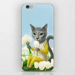 A cat sitting in the flower garden iPhone Skin
