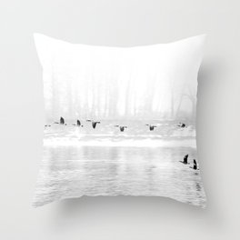 Canadian Geese flying formation  over the river through the fog Throw Pillow