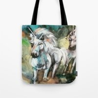 unicorns Tote Bags featuring Unicorns by osile ignacio