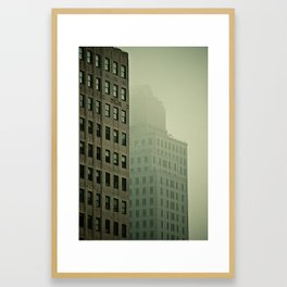 Buildings in downtown New York covered by mist Framed Art Print