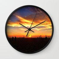"volleyball Wall Clocks featuring Hermosa Beach ""Volleyball"" by Arturo Garcia"