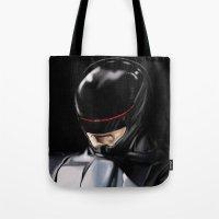 robocop Tote Bags featuring RoboCop (2014) by Jamie Briggs