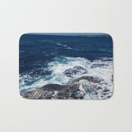 Waves hitting rocks, Clovelly Beach, NSW, Australia Bath Mat