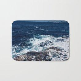 Waves hitting rocks, Clovelly Beach, NSW, Australia Bath Mat
