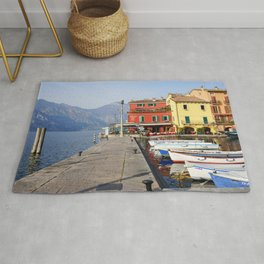 Sunny day in colorful marina of Malcesine  Rug