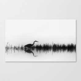 A Great Blue Heron Hunts for Food During a Foggy Morning on the Yellowstone River Canvas Print