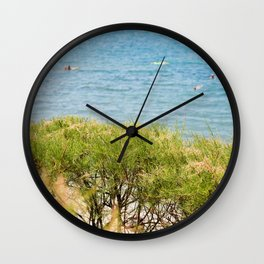 Green bushes and blue sea behind in Istria, Croatian coast Wall Clock