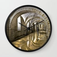 mandie manzano Wall Clocks featuring Winchester Cathedral Crypt by Alice Gosling