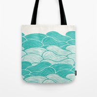 jazzberry Tote Bags featuring The Calm and Stormy Seas by Pom Graphic Design