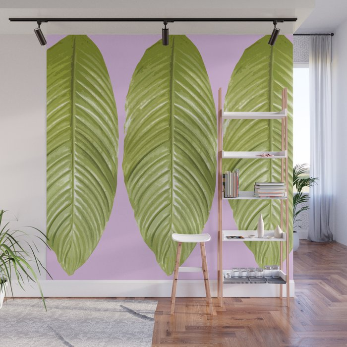 Three large green leaves on a pink background - vivid colors Wall Mural