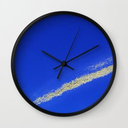 Flash of gold in the sky Wall Clock