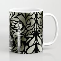 illusion Mugs featuring Skull by Ali GULEC