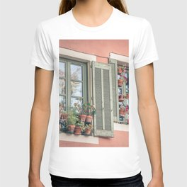 ASSORTED-COLOR FLOWERS IN VASE NEAR WINDOW T-shirt