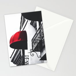 building with porch and red awning in the city Stationery Cards