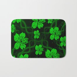 artfully painted green asian  blossoms on the dark background Bath Mat