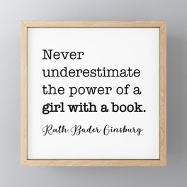 Never underestimate the power of a girl with a book. Framed Mini Art Print