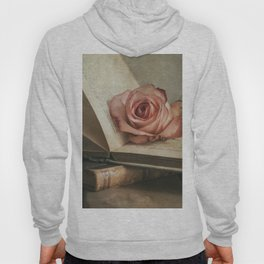 Still life with pink rose and old books Hoody