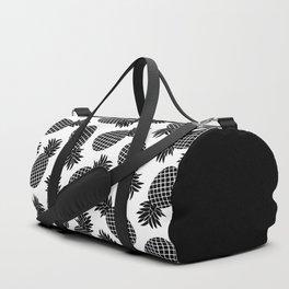 Pineapple In Black Duffle Bag