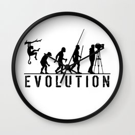 The Evolution Of Man And Cameraman Wall Clock