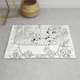 Dalmatian getting a bath relaxing Rug