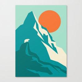 As the sun rises over the peak Canvas Print