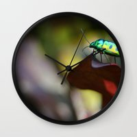 philippines Wall Clocks featuring Iridescent Bug (Philippines) by Dr. Tom Osborne