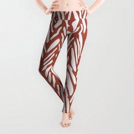Bold contrast herringbone stripe pattern in rusty red Leggings