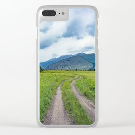 Alpine steppe in the background of snowy mountains Clear iPhone Case