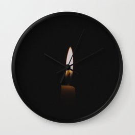 Flickering Candle in Darkness Wall Clock