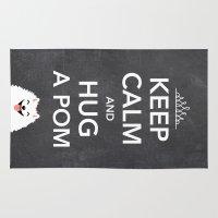 pomeranian Area & Throw Rugs featuring Keep Calm And Hug A Pom - Pomeranian by Jenn Inashvili