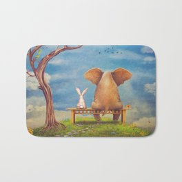 Elephant and rabbit sit on a bench on the glade Bath Mat