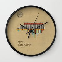 north carolina Wall Clocks featuring North Carolina state map by bri.buckley