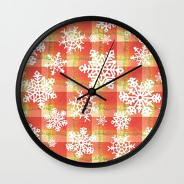 Snowflakes against red plaid Wall Clock