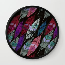 Multi colored feathers on black background . Wall Clock