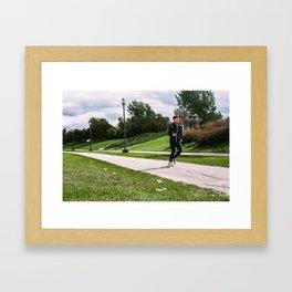 Jogger on an overcast day in the park Framed Art Print