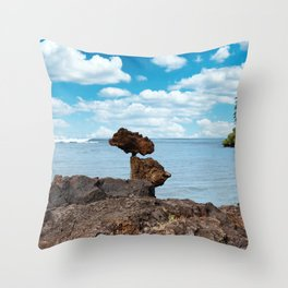 Stacked Rocks with ocean background  Throw Pillow