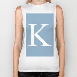 Letter K sign on placid blue background Biker Tank