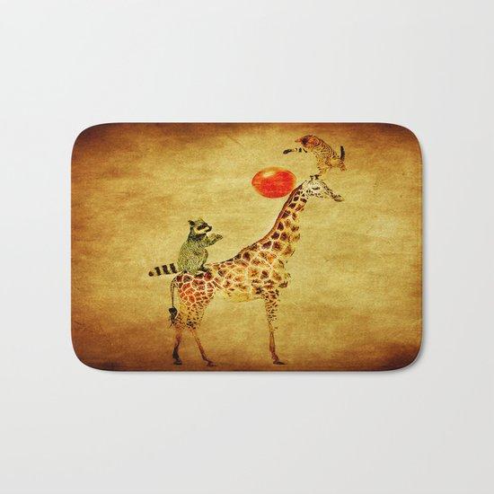 By playing on the giraffe Bath Mat