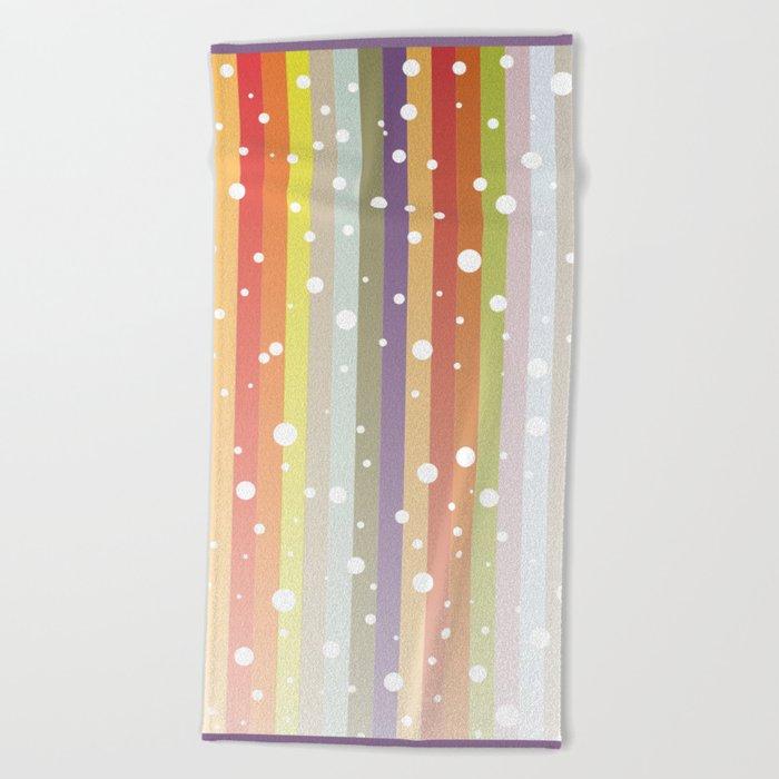 Snow falls on the rainbow Beach Towel
