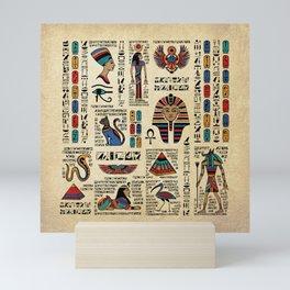 Egyptian hieroglyphs and deities on papyrus Mini Art Print