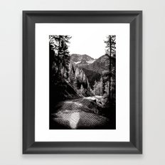 The road through the forrest below the mountains Framed Art Print