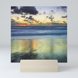 Sea storm approaching the beach making reflections in the sand Mini Art Print