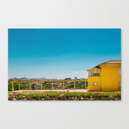 Yellow house with a view Canvas Print